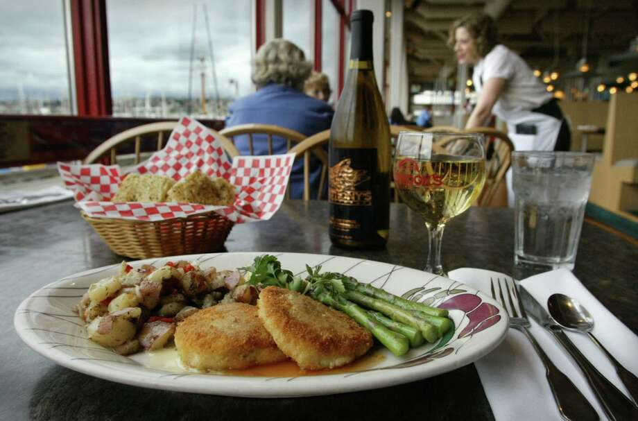What is Seattle known for doing with Dungeness crabs? Crab cakes, of course, beloved by locals and tourists alike at Chinook's at Salmon Bay. Photo: GILBERT W. ARIAS, SEATTLE POST INTELLIGENCER  / Seattle Post-Intelligencer
