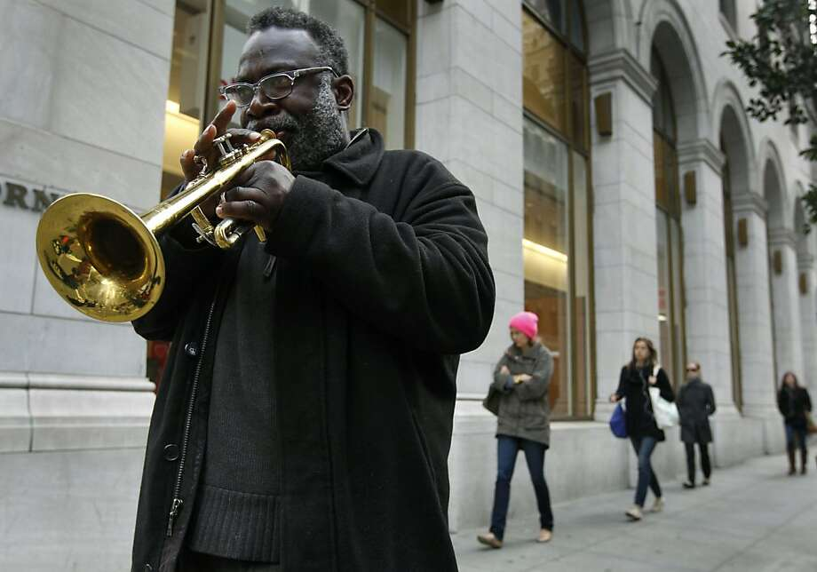 Street musician Reginald Conyers serenades office workers as they head to their jobs at California and Sansome streets. S.F. is his latest stop in a multi-city trip, but he's planning to head out of town soon. Photo: Paul Chinn, The Chronicle