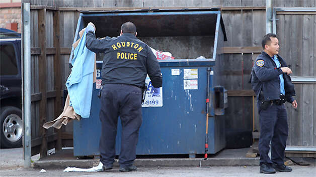 Authorities look for a baby wrapped in a blanket Wednesday, Feb. 13, 2013. Photo: Nick De La Torre / Houston Chronicle