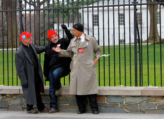 Civil Rights leader Julian Bond, right, talks with Chesapeake Climate Action Network Executive Director, Mike Tidwell, center, and another activist as they are chained to a fence at the White House in Washington, Wednesday, Feb. 13, 2013, as prominent environmental leaders tied themselves to the White House gate to protest the Keystone XL oil pipeline. Photo: Ann Heisenfelt, Associated Press / FR13069 AP