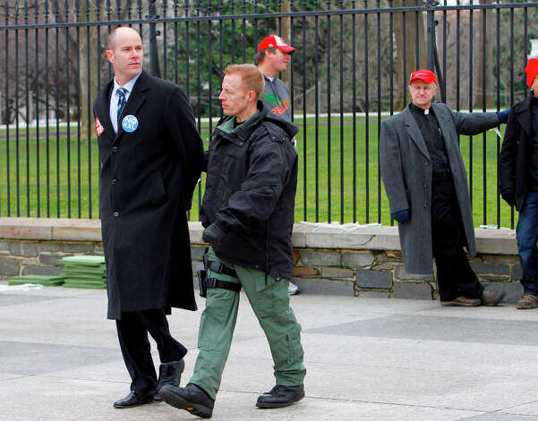 Sierra Club Executive Director Michael Brune is arrested outside the White House in Washington, Wednesday, Feb. 13, 2013, as prominent environmental leaders tied themselves to the White House gate to protest the Keystone XL oil pipeline. Photo: Ann Heisenfelt, Associated Press / FR13069 AP