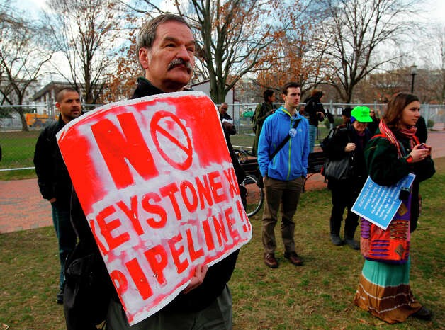 Protestors gather in Lafayette Park, across the street from the White House in Washington, Wednesday, Feb. 13, 2013, before prominent environmental leaders tied themselves to the White House gate to protest the Keystone XL oil pipeline. Photo: Ann Heisenfelt, Associated Press / FR13069 AP