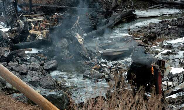 The charred and melted remains of a gasoline tanker truck looking from the rear to the front, lies at the bottom of a hill below Route 7 Feb. 13, 2013 after is left the road and exploded in Hoosick, N.Y.   The driver received burns and was ultimately transported to the Westchester Burn Center.   (Skip Dickstein/Times Union) Photo: SKIP DICKSTEIN