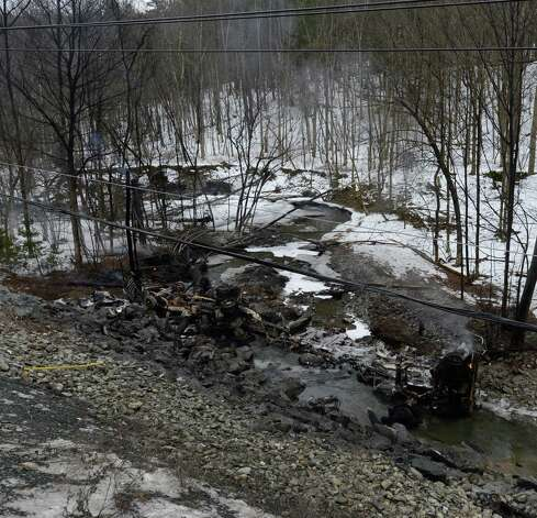 The remains of a gasoline tanker truck looking from the rear to the front, lies at the bottom of a hill below Route 7 Feb. 13, 2013 after is left the road and exploded in Hoosick, N.Y.   The driver received burns and was ultimately transported to the Westchester Burn Center.   (Skip Dickstein/Times Union) Photo: SKIP DICKSTEIN