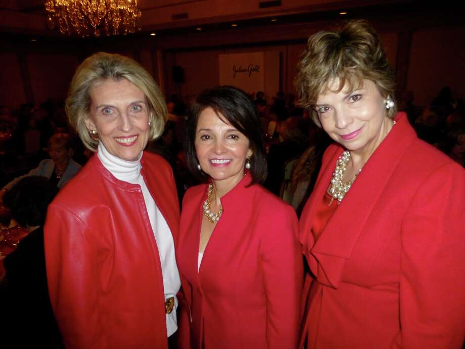 Friends of Hospice President Beverly Purcell-Guerra (from left) and Valentine Luncheon co-chairs Tenchita Flores and Caro Canales enjoy the annual style show at the San Antonio Country Club. Photo: Nancy Cook-Monroe, For The Express-News