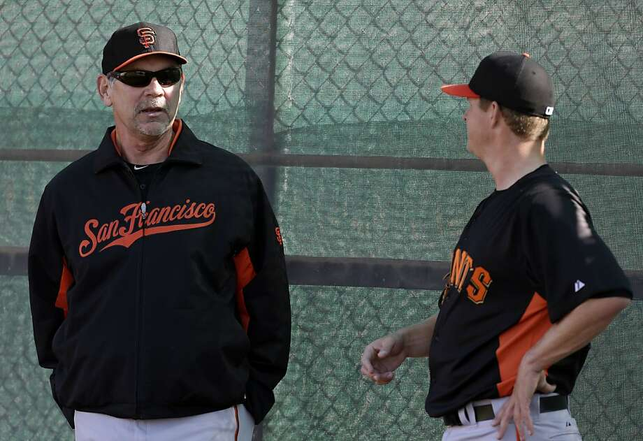 San Francisco Giants manager Bruce Bochy, left, talks with Matt Cain during a spring training baseball workout Wednesday, Feb. 13, 2013, in Scottsdale, Ariz. (AP Photo/Darron Cummings) Photo: Darron Cummings, Associated Press