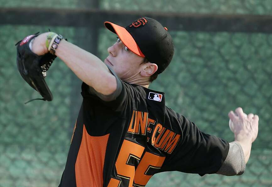 San Francisco Giants' Tim Lincecum throws during a spring training baseball workout Wednesday, Feb.