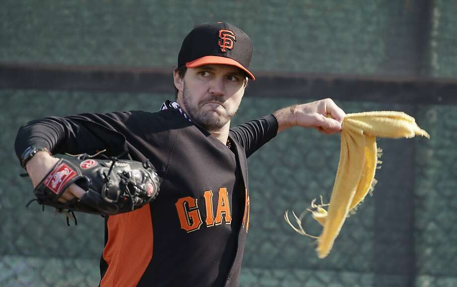San Francisco Giants' Barry Zito simulates his throwing motion during a spring training baseball workout Wednesday, Feb. 13, 2013, in Scottsdale, Ariz. (AP Photo/Darron Cummings) Photo: Darron Cummings, Associated Press