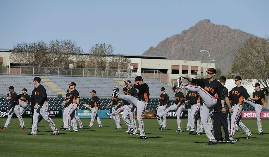 San Francisco Giants players stretch before a spring training baseball workout Wednesday, Feb. 13, 2013, in Scottsdale, Ariz. (AP Photo/Darron Cummings) Photo: Darron Cummings, Associated Press