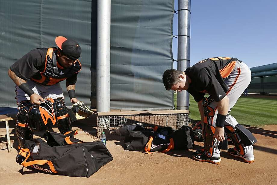 San Francisco Giants catcher Buster Posey, right, and Hector Sanchez put on their gear during spring training baseball workout Wednesday, Feb. 13, 2013, in Scottsdale, Ariz. (AP Photo/Darron Cummings) Photo: Darron Cummings, Associated Press