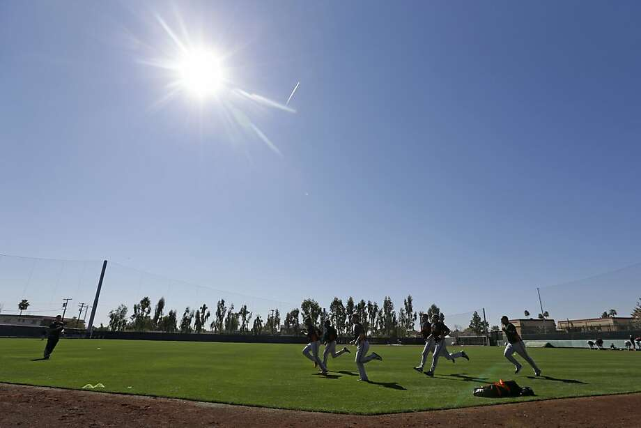 San Francisco Giants pitchers run during a spring training baseball workout Wednesday, Feb. 13, 2013, in Scottsdale, Ariz. (AP Photo/Darron Cummings) Photo: Darron Cummings, Associated Press