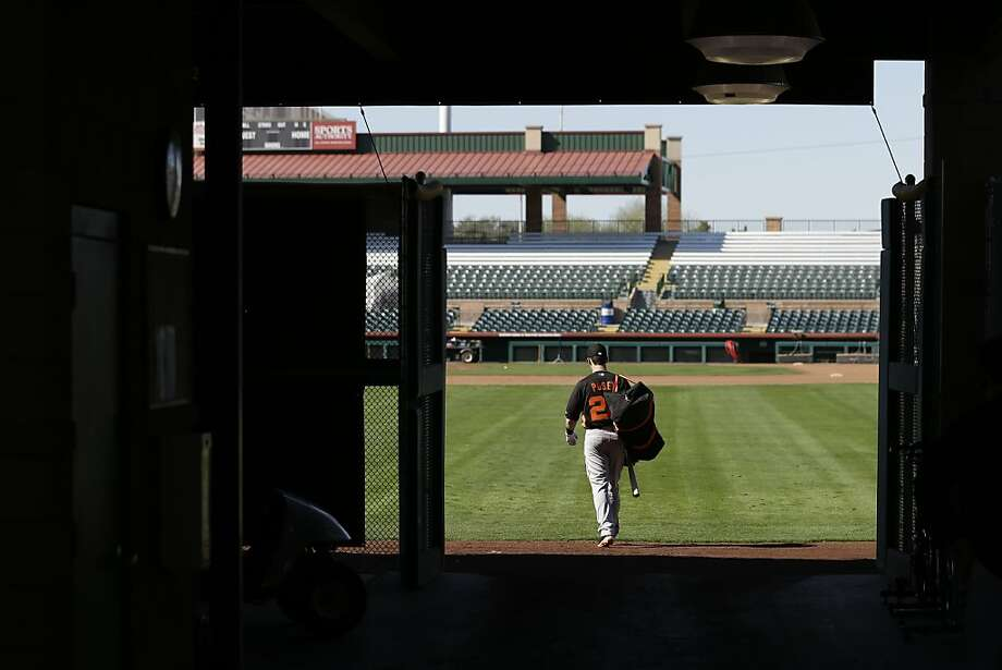San Francisco Giants catcher Buster Posey walks out to the field after hitting in the batting cages during a spring training baseball workout Wednesday, Feb. 13, 2013, in Scottsdale, Ariz. (AP Photo/Darron Cummings) Photo: Darron Cummings, Associated Press