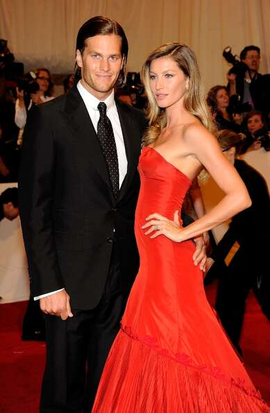 Tom Brady and Gisele Bundchen attends the Alexander McQueen: Savage Beauty Costume Institute Gala at