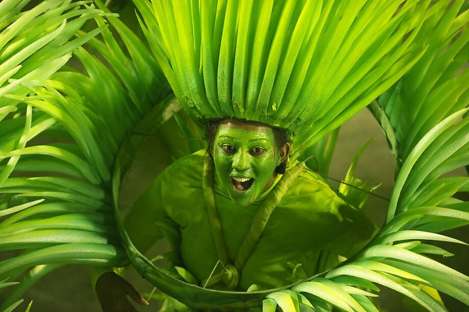 Less skin, more foliage:Another dancer from the same Vila Isabel samba school shakes her grass during carnival. Photo: Antonio Scorza, AFP/Getty Images