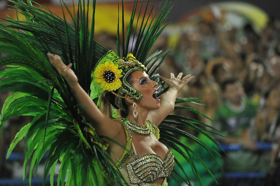 Like Beyonce, but with feathers: A Vila Isabel samba school dancer shows off her vocal talents before Fat Tuesday turns into Ash Wednesday in Rio. Photo: Christophe Simon, AFP/Getty Images