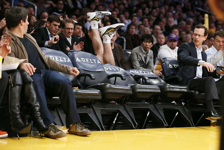 Unfortunately Jack Nicholson wasn't there to break his fall: The Lakers' Steve Blake takes a seat while diving for a ball during a game against the Suns in Los Angeles. Photo: Danny Moloshok, Associated Press