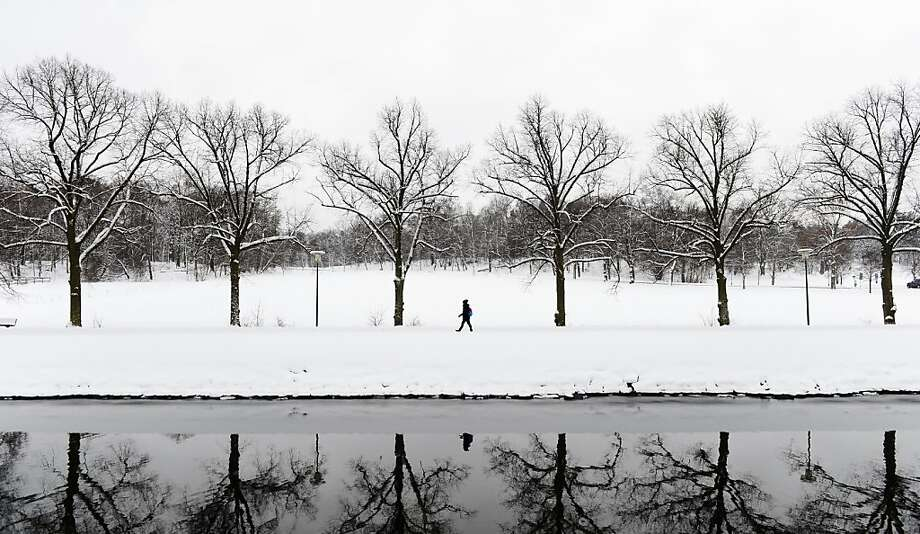 TOPSHOTS A woman strolls on February 13, 2012 in Djurgarden park under the snow in Stockholm. AFP PHOTO/JONATHAN NACKSTRANDJONATHAN NACKSTRAND/AFP/Getty Images Photo: Jonathan Nackstrand, AFP/Getty Images