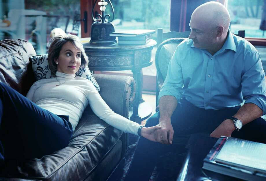 This undated image provided by Vogue shows former Rep. Gabrielle Giffords, D-Ariz., left, with her husband, former astronaut Mark Kelly, during a photo shoot at their home in Tucson, Ariz. The image and accompanying article by John Powers will be published in the March 2013 issue of Vogue, available on newsstands nationwide on Feb. 19. (AP Photo/Norman Jean Roy for Vogue) Photo: Norman Jean Roy