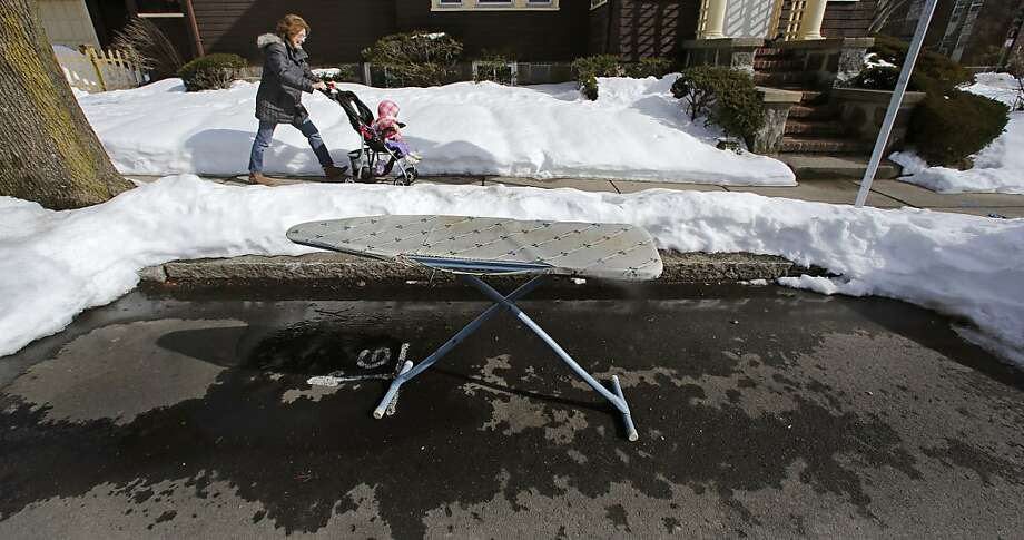 It's outrageousthat an ironing board is taking up this entire parking space in New Bedford, Mass. There's plenty of room for two ironing boards. Photo: Charles Krupa, Associated Press
