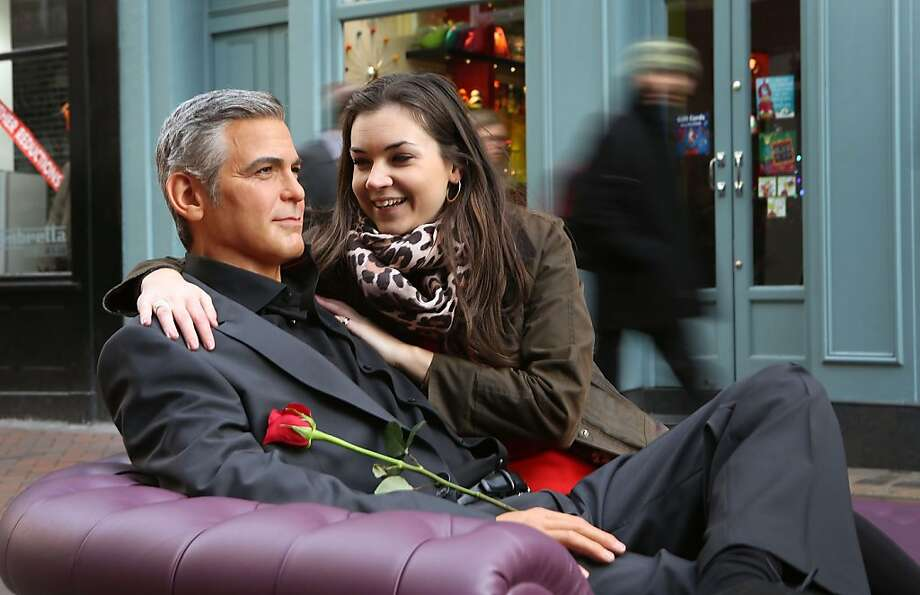 Check out my new boyfriend: He's so romantic, buying me roses and all. Kinda quiet, but what a dreamboat! (Madame Tussauds' latest waxwork sits on a sofa off London's Carnaby Street.) Photo: Tim Whitby, Getty Images