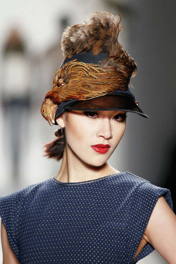 Hat with taxidermy bird. CZAR by Cesar Galindo Fall 2013.  Photo: Peter Michael Dills, AP/Getty / 2013 Getty Images