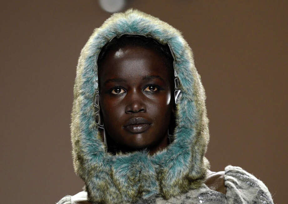 Blue fur hoodie. Custo Barcelona Fall 2013 collections.  Photo: STAN HONDA, AP/Getty / AFP