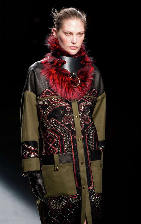 Red fur doggie-collar necklace? Prabal Gurung fashion week. Photo: DON EMMERT, AP/Getty / AFP