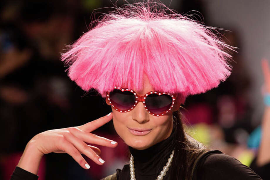 Pink wig/hat and glasses. Betsey Johnson Fall 2013.  Photo: John Minchillo, AP/Getty / FR170537 AP