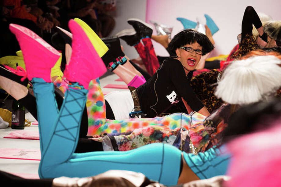 Hot pink tennis shoes. The Betsey Johnson Fall 2013 collection.  Photo: John Minchillo, AP/Getty / FR170537 AP