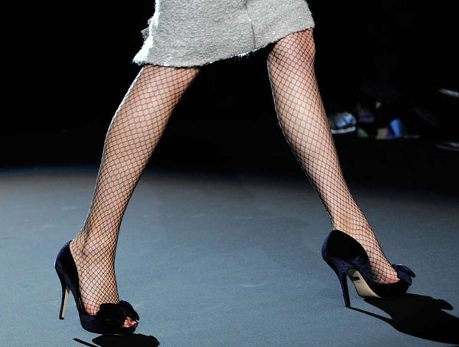Simple black heels and fishnet stockings.  Badgley Mischka Fall 2013 collection.  Photo: Louis Lanzano, AP/Getty / FR77522 AP