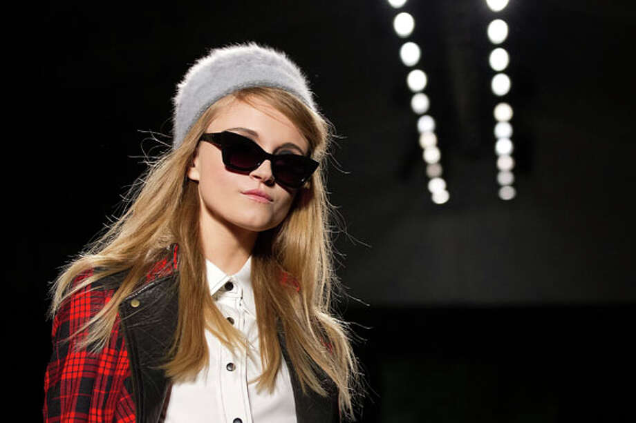 Fuzzy hats and sunglasses. The Tracy Reese Fall 2013 collection. Photo: Dario Cantatore, AP/Getty / Invision