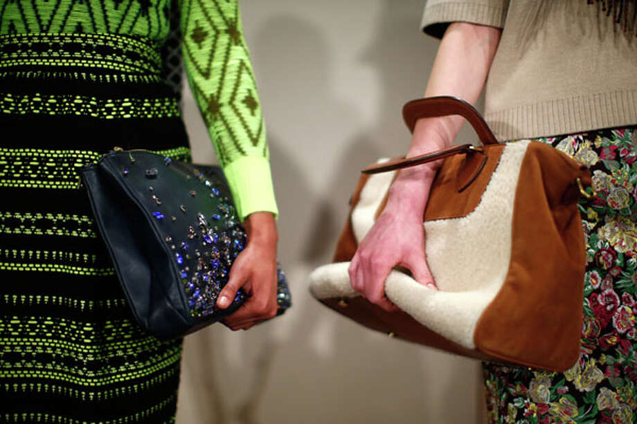 Clutches. J Crew Fall 2013 collections.  Photo: ERIC THAYER, AP/Getty / AFP