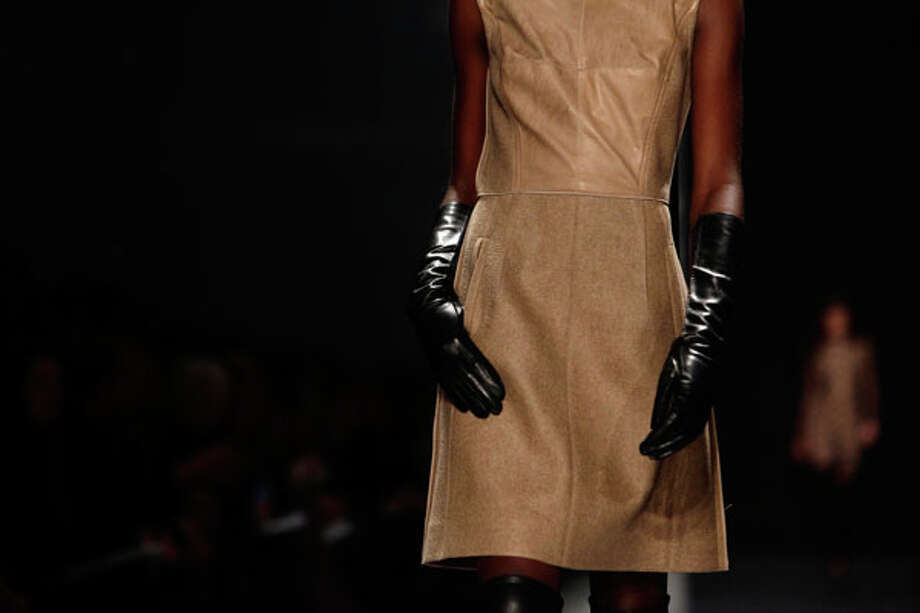 Black gloves. Kaufmanfranco Fall 2013.  Photo: JOSHUA LOTT, AP/Getty / 2013 AFP