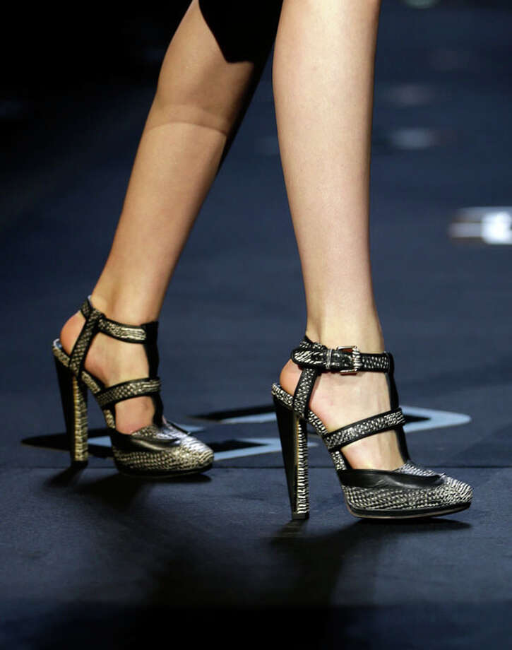 Strappy heels. The Diane von Furstenberg Fall 2013 collection.  Photo: Seth Wenig, AP/Getty / AP