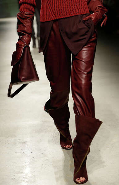 Matching red gloves, purse, leather pants and tunic. Kenneth Cole Fall 2013.
