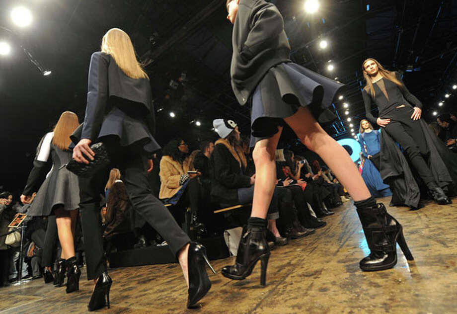 Clunky heels worn with socks. The DKNY Fall 2013 collection.  Photo: Louis Lanzano, AP/Getty / FR77522 AP