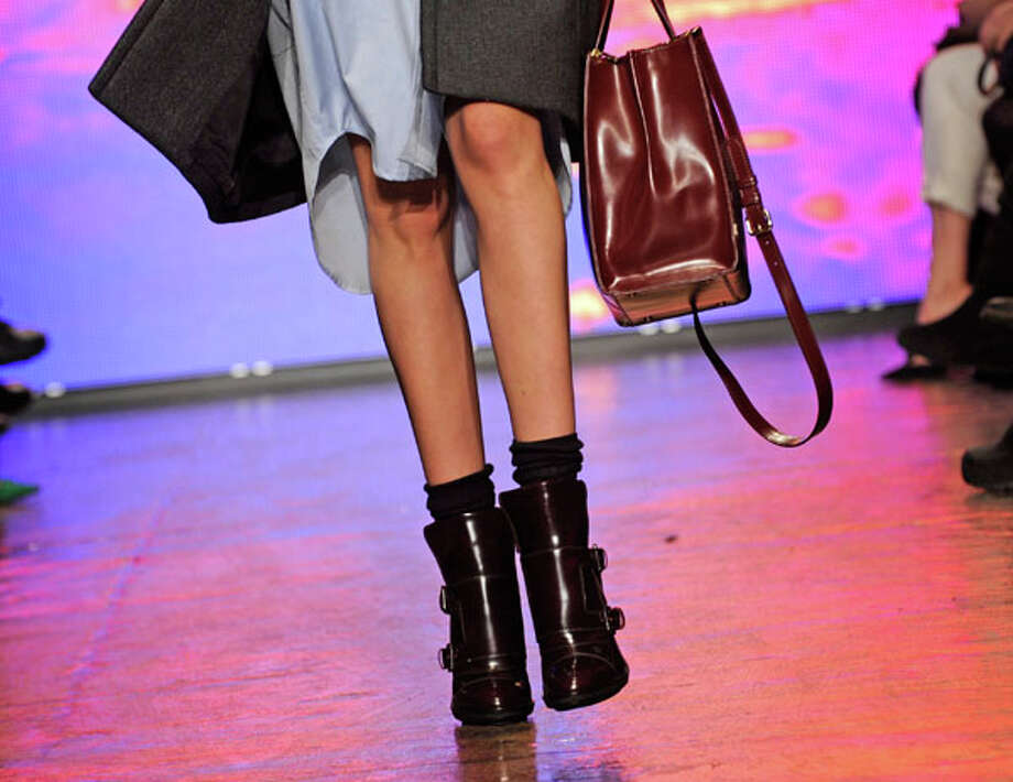 Big purse, clunky boots. The DKNY Fall 2013 collection.  Photo: Louis Lanzano, AP/Getty / FR77522 AP