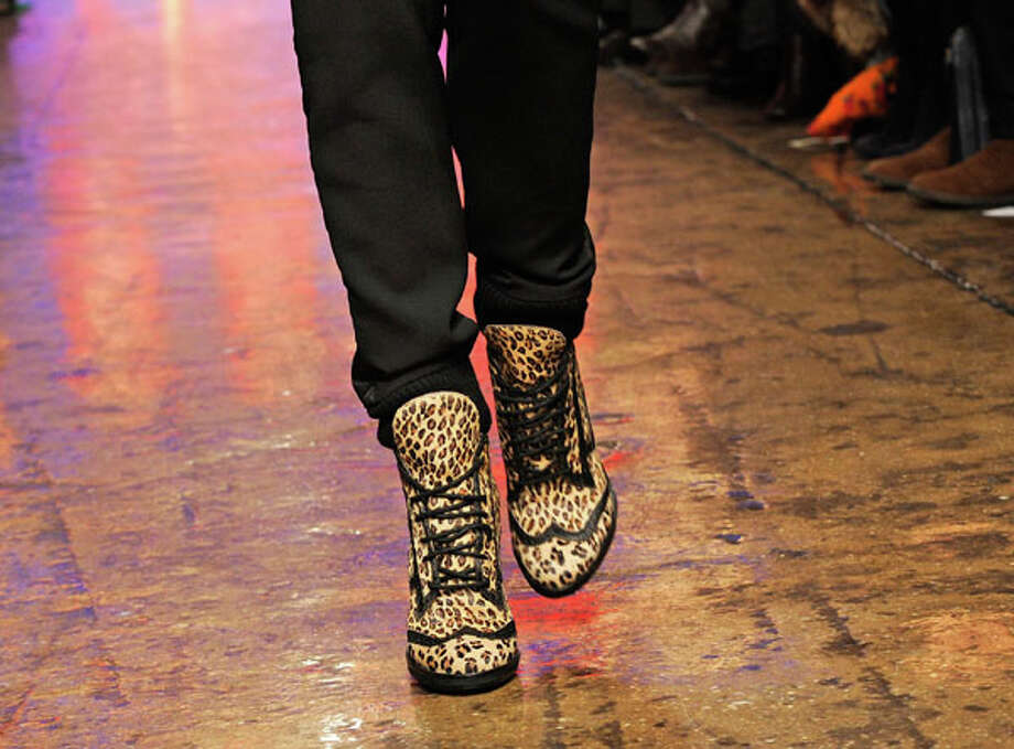 Leapord-print boots. The DKNY Fall 2013 collection.  Photo: Louis Lanzano, AP/Getty / FR77522 AP