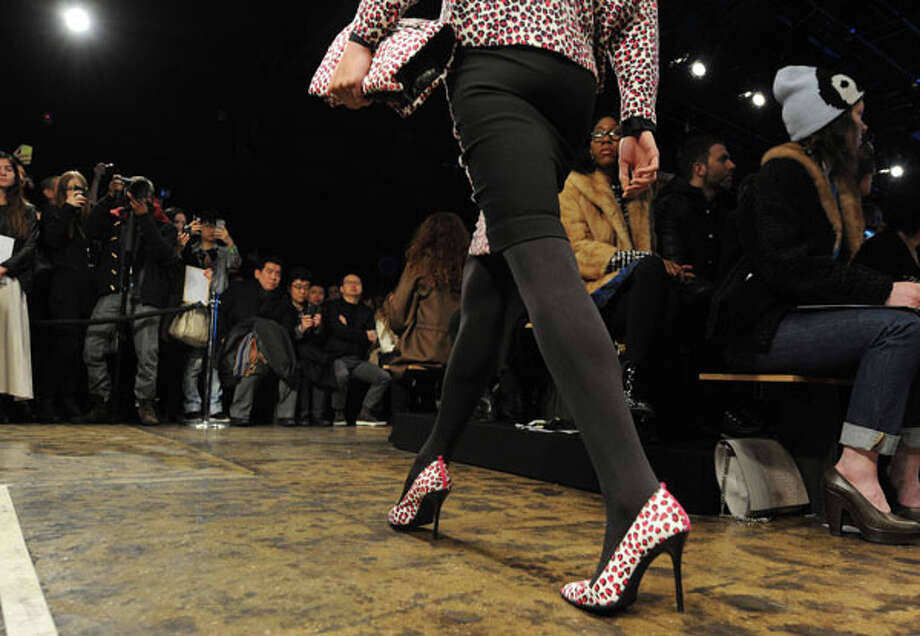 Pink leopard-print heels. The DKNY Fall 2013 collection.  Photo: Louis Lanzano, AP/Getty / FR77522 AP