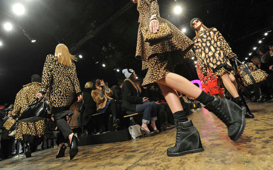 Combat boots and heels. The DKNY Fall 2013 collection.  Photo: Louis Lanzano, AP/Getty / FR77522 AP