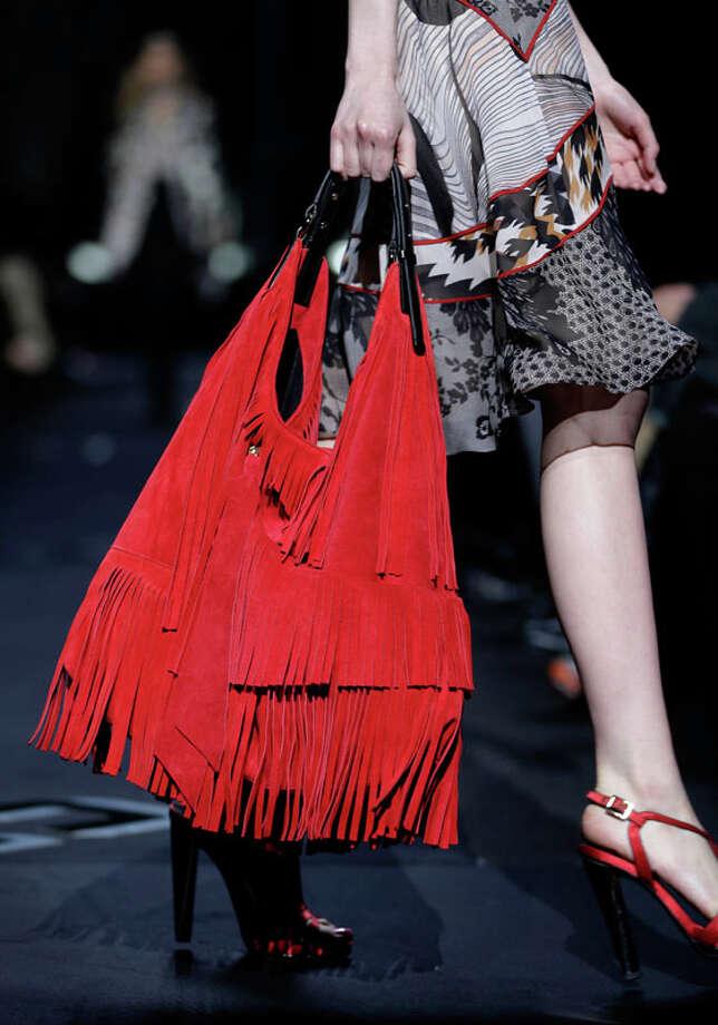 Big fringe purse. The Diane von Furstenberg Fall 2013 collection.  Photo: Seth Wenig, AP/Getty / AP