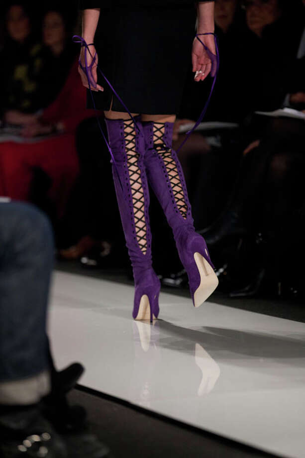 Thigh-high, lace-up purple boots. Ralph Rucci Fall 2013.  Photo: Karly Domb Sadof, AP/Getty / AP