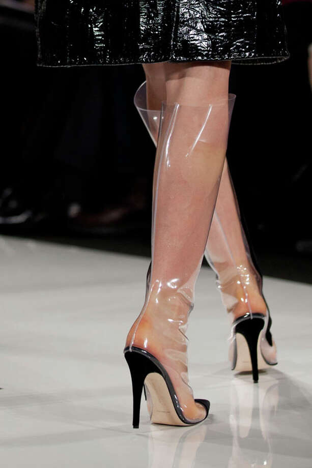 Knee-high, see-through, galosh-like stiletto heels. Ralph Rucci Fall 2013.  Photo: Karly Domb Sadof, AP/Getty / AP