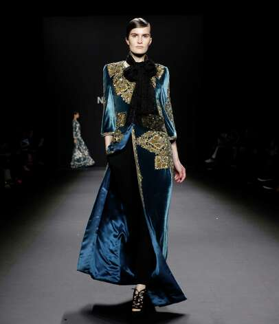 The Naeem Khan Fall 2013 collection is modeled during Fashion Week in New York, Tuesday, Feb. 12, 2013.  (AP Photo/Kathy Willens) Photo: Kathy Willens, Associated Press / AP