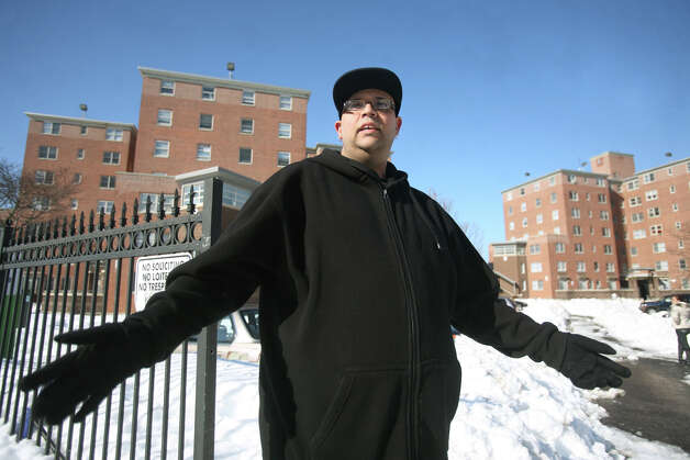 Miguel Villafane, a resident of Charles F. Greene Homes housing project in Bridgeport, has been missing work because of the lack of snow removal at both the complex and adjacent Highland Avenue. Photo: Brian A. Pounds / Connecticut Post