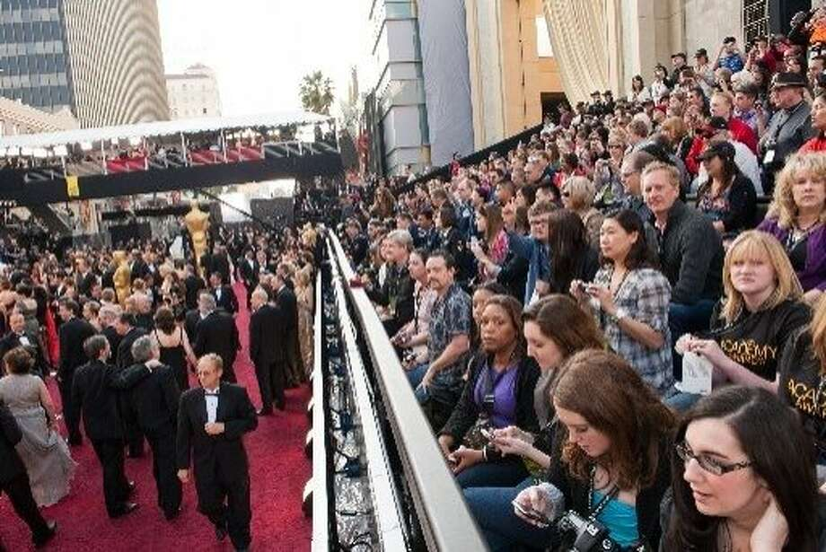 Just 700 people out of 20,000 or so applicants are selected to get bleacher seats to watch the stars arrive on the red carpet for the Academy Awards. Photo: Ivan Vejar, AMPAS