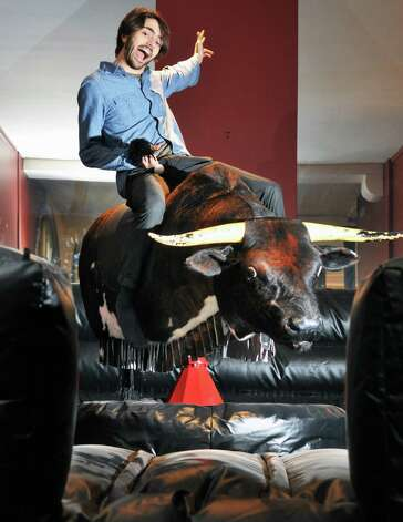 City Beer Hall co-owner Kaelin Ballinger atop the mechanical bull in the Rodeo room of the new multilevel entertainment space in Albany Tuesday morning May 17, 2011. (John Carl D'Annibale / Times Union) Photo: John Carl D'Annibale / 00013054A