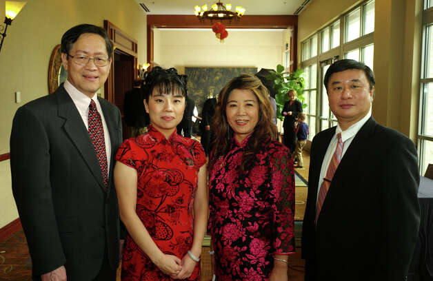 Chinese Society of San Antonio's Chinese New Year gala: Board members Chien Liu (from left), President Jing Yang, Chu Li Shelton and Charles Chen gather for the gala at the Hill Country Hilton Hotel. Photo: LELAND A. OUTZ, For The Express-News / SAN ANTONIO EXPRESS-NEWS