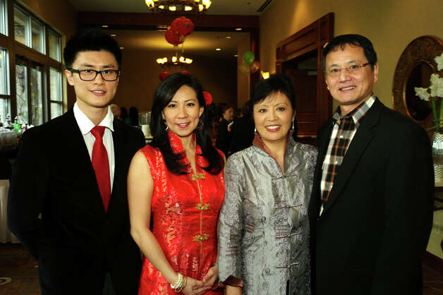 Chinese Society of San Antonio's Chinese New Year gala: Event emcee Menhsin Chen (from left) and board members Elva Adams, Ming Xie and Weixue Su gather at the gala at the Hill Country Hilton Hotel. Photo: LELAND A. OUTZ, For The Express-News / SAN ANTONIO EXPRESS-NEWS