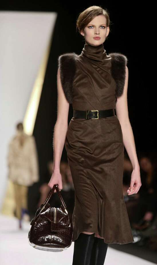 The Fall 2013 collection of J. Mendel featured discreet elegance, rich fabrics and fur. Photo: Bebeto Matthews, STF / AP